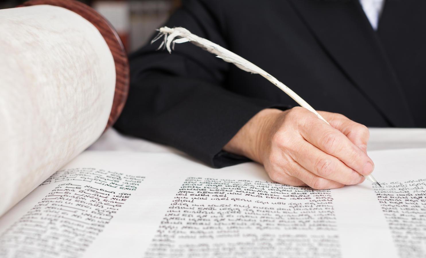 Scribe writing a Torah